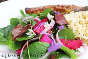 Dragon fruit and spinach salad with white wine vinegar and truffle oil