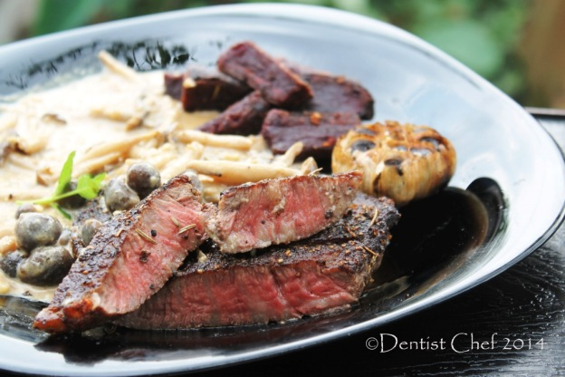 medium rare wagyu beef steak with creamy mushrooms sauce
