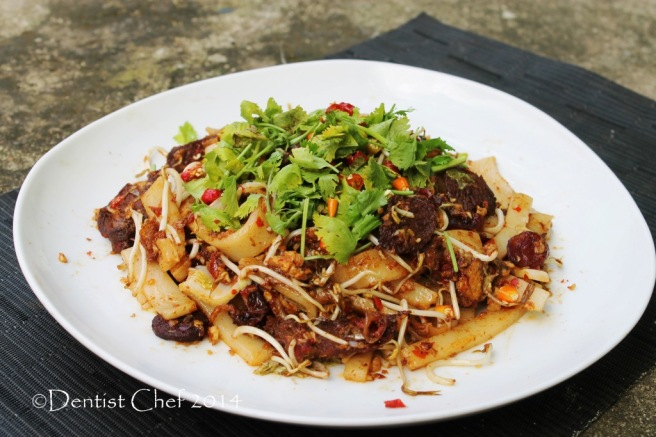 homemade char kway teow beef wagyu asian flat rice cake noodle xo sauce stir fried with chinese sausage lap chong chili cilantro soy sauce