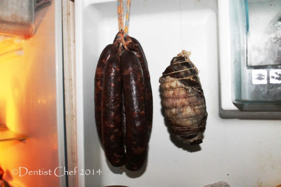 homemade pancetta hung in refrigerator home curing chamber fridge lamb belly dried cured pancetta di agnello