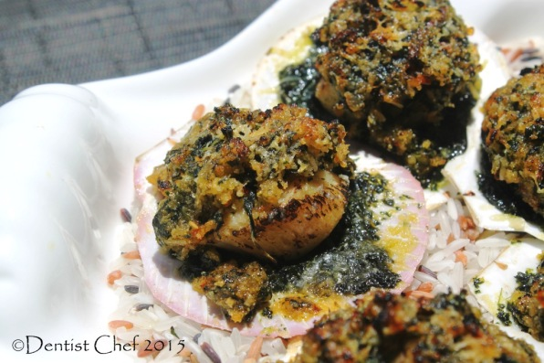 broiled scallops in shell rockefeller recipe cheese breadcrumbs crumbled spinach parsley basil butter topped scallops