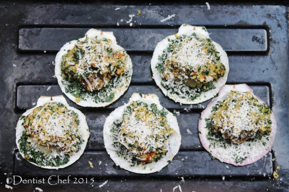 Recipe broiled scallop rockefeller cheese gratin parmigiano reggiano rockefeller sauce scallops in shell with basil parsley spinach breadcrumbs