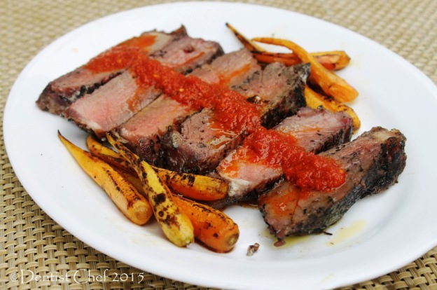 roasted beef sirloin salt crust with red pepper sauce burnt chili pesto