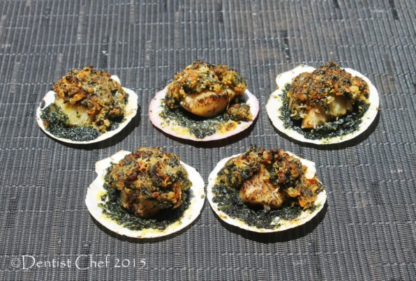 roasted scallops in half shell rockefeller broiled with cheese breadcrumbs spinach puree basil parsley