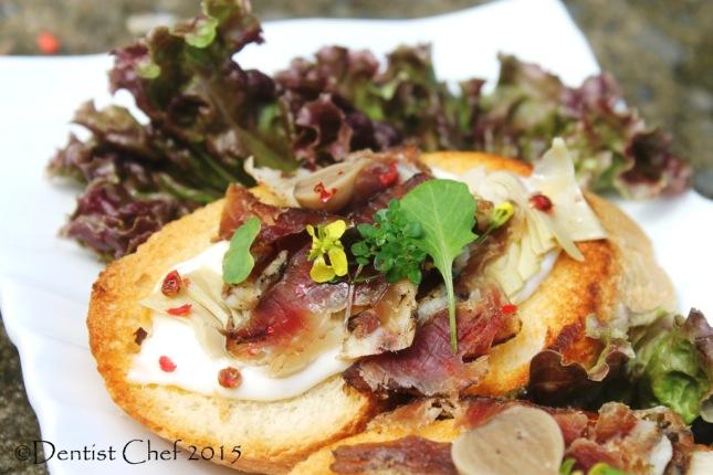 bruchetta goat prosciutto capra cheese lettuce mustard leaves pink peppercorn