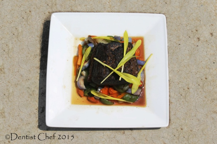 Confit beef brisket in duck fat tender meat gravy sauteed spring vegetables gourmet popcorn shoots microgreen sweet corn