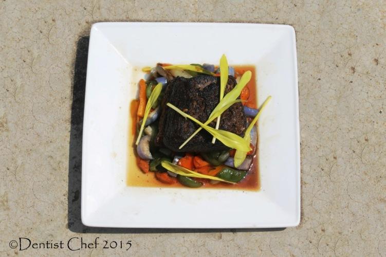 Confit beef brisket in duck fat tender meat gravy sauteed spring vegetables gourmet popcorn shoots microgreen sweet corn