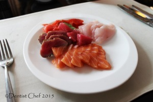 sashimi platter salmon belly raw tuna seabass seared tuna octopus signatures restaurant kempinski hotel indonesia jakarta