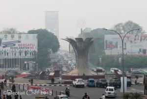 Palembang kabut asap jembatan ampera toyota avanza
