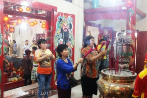praying buddha buddism in temple palembang pulo kemaro lantern festival